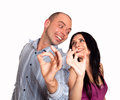 Man and woman showing you ok sign women smiling Stock Photography