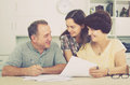 Man and woman signing documents Royalty Free Stock Photo