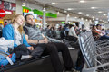 Man and woman sitting at airport terminal and talking Royalty Free Stock Photo