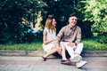 Man and woman sitting on the curb Royalty Free Stock Photo