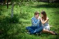 Man and woman sitting on the grass Royalty Free Stock Photo