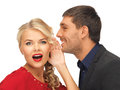 Man and woman spreading gossip bright picture of men women focus on Stock Photo