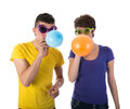 Man and woman with sunglasses blowing balloons women isolated over white Stock Image