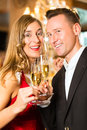 Man and woman tasting Champagne in restaurant Stock Images