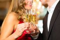 Man and woman tasting Champagne in restaurant Royalty Free Stock Photo