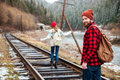 Man and woman walking on old railroad in mountains Royalty Free Stock Photo