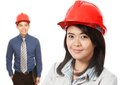 Man and Woman Wearing Hardhats Stock Photos