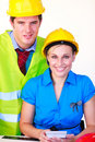 Man and women with hard hat Stock Photos