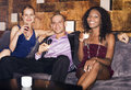Man with women sitting on couch in bar portrait of a men two Stock Photo