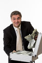 Man won the jackpot surprised with a suitcase full of dollars happy businessman with a suitcase of money Royalty Free Stock Photos