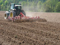 Man work with tractor and harrow