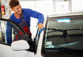 Man worker polishing car on a car wash Royalty Free Stock Photo