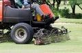 Man Worker riding mower machine cutting fairway. Royalty Free Stock Photo
