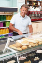 Man Working Behind Counter In Cafe Stock Images