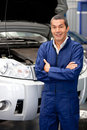 Man working at a car garage Stock Photo