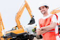 Man working with contruction machines happy and wearing helmet Royalty Free Stock Photo