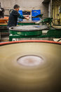 Man Working a Glass Blown Vase on Silica Sanding Disk Royalty Free Stock Photo