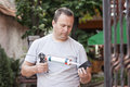 Man working gluing with silicone gun Stock Photos