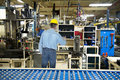 Man Working in Industrial Manufacturing Factory Royalty Free Stock Photo