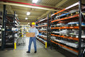 Man Working in Industrial Manufacturing Warehouse Royalty Free Stock Photo