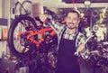 Man working on master mechanic assembling bicycle equipment