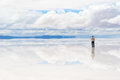 Man working on mobile phone the in the middle of lake salar de uyuni bolivia Stock Photos