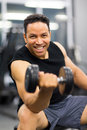 Man working out dumbbell handsome with Stock Photos