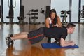 Man working out with his pesonal trainer while female personal instructor assisting him Stock Images