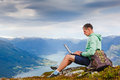 Man working outdoors with laptop Royalty Free Stock Photo