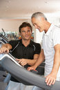 Man Working With Personal Trainer Royalty Free Stock Photos