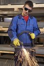 Man working with plasma cutter Royalty Free Stock Photo