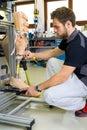 Man working on prosthetic leg assembly Royalty Free Stock Photo
