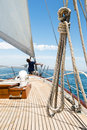 Man working on prow of yacht Royalty Free Stock Photo