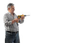 A man works an electric drill worker old in studio Stock Photo