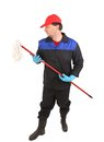 Man in workwear with mop. Royalty Free Stock Photo