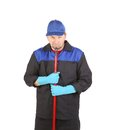 Man in workwear with mop isolated on a white background Royalty Free Stock Image