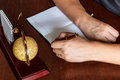 Man writes with his left hand in the diary entries. Royalty Free Stock Photo