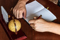Man writes with his left hand in the diary entries handed Stock Photos