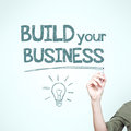 Man writing build your business motivational image Stock Photography