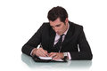 Man writing in a diary something Royalty Free Stock Image
