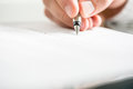 Man writing on a document with a fountain pen Royalty Free Stock Photo