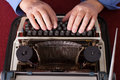 man writing on old typewriter Royalty Free Stock Photo