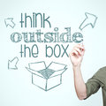 Man writing think outside the box on the board Royalty Free Stock Images