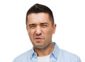 Man wrying of unpleasant smell emotions facial expression and people concept Royalty Free Stock Photo