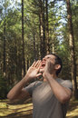 Man yelling all alone in woods young standing and Royalty Free Stock Photos