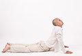 Man in yoga position dressed white relaxing doing and stretching Stock Photography