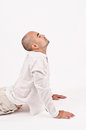 Man in yoga position dressed white relaxing doing and stretching Royalty Free Stock Images
