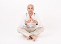 Man in yoga position dressed white sitting relaxing and doing Stock Images