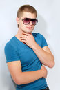 Man young handsome athlete with sunglasses Stock Photography