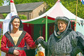 Man and yourn woman in medieval costume senior young participants at the fayre one of the most popular annual events of the Stock Photo